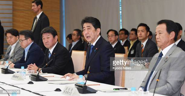 Japanese Prime Minister Shinzo Abe and Finance Minister Taro Aso attend a meeting of the Council on Economic and Fiscal Policy at the prime...