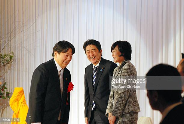Japanese Prime Minister Shinzo Abe and first lady Akie Abe are greeted by Agriculture Minister Yoshimasa Hayashi during a new year party on January 4...