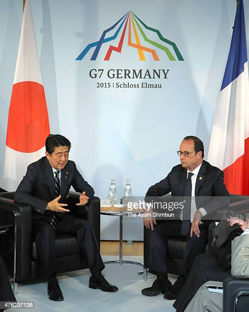 Japanese Prime Minister Shinzo Abe and French President Francois Hollande talk during their bilateral meeting on the sidelines of the summit of G7...