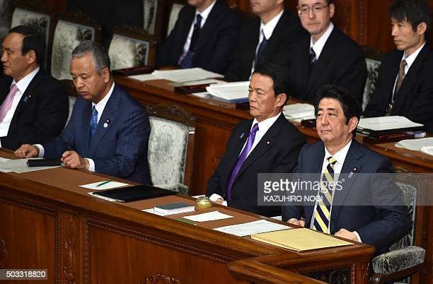 Japanese Prime Minister Shinzo Abe and his cabinet members Finance Minister Taro Aso Economic and Fiscal Policy Minister Akira Amari and Chief...