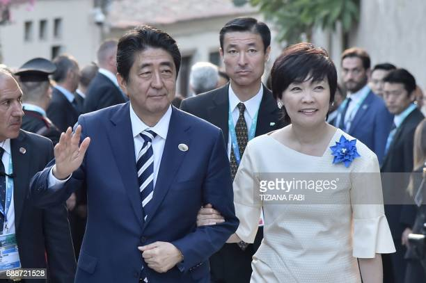 Japanese Prime Minister Shinzo Abe and his wife Akie Abe arrive for a concert of La Scala Philharmonic Orchestra at the ancient Greek Theatre of...