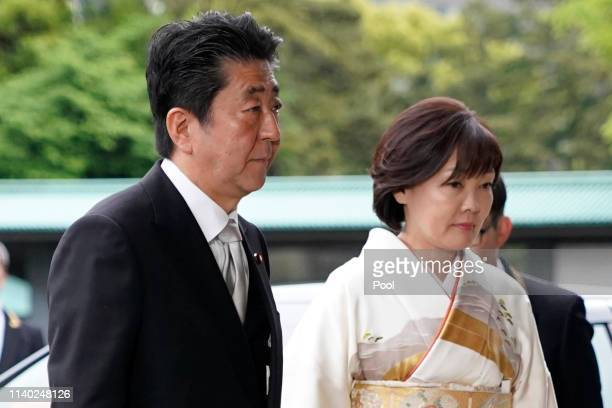 Japanese Prime Minister Shinzo Abe and his wife Akie Abe arrive for Emperor Akihito's abdication ceremony at the Imperial Palace on April 30, 2019 in...