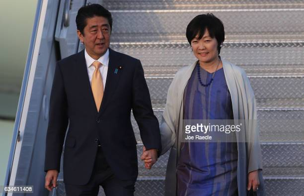Japanese Prime Minister Shinzo Abe and his wife Akie Abe arrive on Air Force One at the Palm Beach International airport as they prepare to spend...