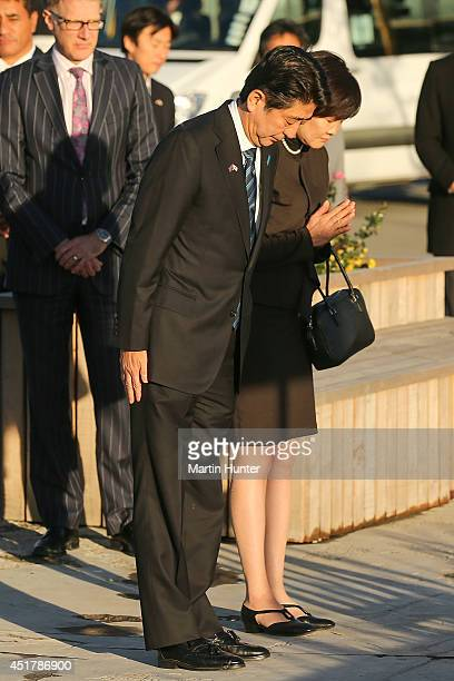 Japanese Prime Minister Shinzo Abe and his wife Akie Abe lay a wreath at the CTV site on July 7 2014 in Christchurch New Zealand Prime Minister Abe...