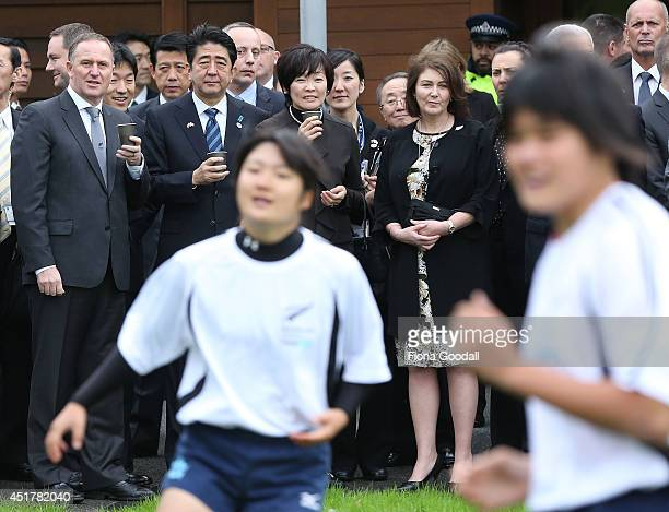 Japanese Prime Minister Shinzo Abe and his wife Akie Abe with New Zealand Prime Minister John Key and his wife Bronagh watch Game on English students...
