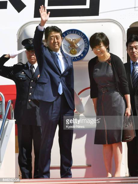 Japanese Prime Minister Shinzo Abe and his wife Akie are pictured at Tokyo's Haneda airport on Sept 13 2017 before departing on a threeday trip to...