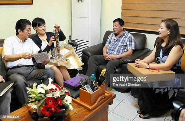 Japanese Prime Minister Shinzo Abe and his wife Akie exchange gifts with Philippines President Rodrigo Duterte and his wife Honeylet Avancena prior...