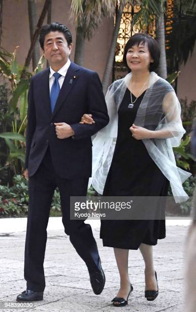 Japanese Prime Minister Shinzo Abe and his wife Akie head for a dinner reception with US President Donald Trump and his wife Melania in Palm Beach...