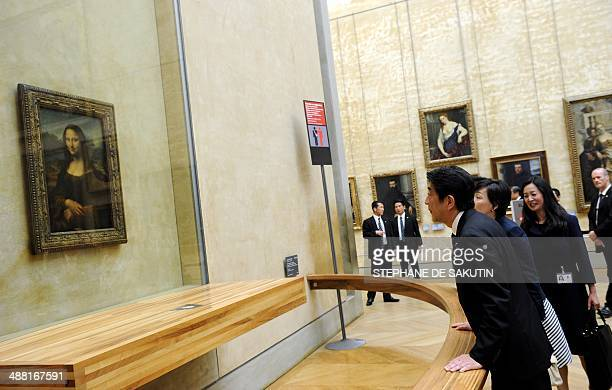 Japanese Prime Minister Shinzo Abe and his wife Akie look at 'La Joconde' a 15031506 oil on wood portrait of Mona Lisa by Leonardo Da Vinci at the...