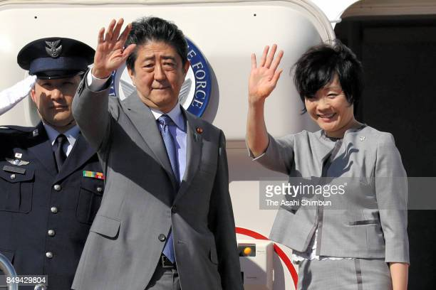 Japanese Prime Minister Shinzo Abe and his wife Akie wave on departure at Haneda International Airport on September 18 2017 in Tokyo Japan Abe is on...