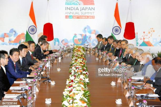Japanese Prime Minister Shinzo Abe and Indian Prime Minister Narendra Modi talk during their meeting on September 14 2017 in Gandhinagar India Abe is...
