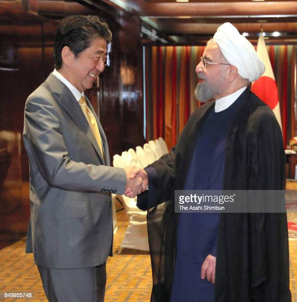 Japanese Prime Minister Shinzo Abe and Iranian President Hassan Rouhani shake hands prior to their meeting on September 19 2017 in New York City Abe...