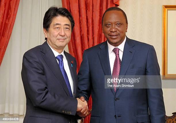Japanese Prime Minister Shinzo Abe and Kenyan President Uhuru Kenyatta shake hands prior to their meeting on September 26 2015 in New York City Prime...