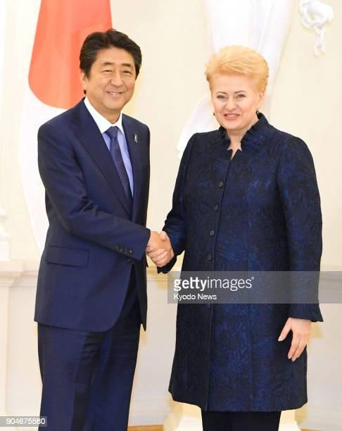 Japanese Prime Minister Shinzo Abe and Lithuanian President Dalia Grybauskaite shake hands in Vilnius on Jan 13 2018 ==Kyodo