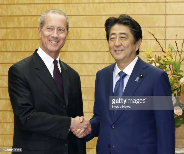 Japanese Prime Minister Shinzo Abe and Mac Thornberry, chairman of the U.S. House Armed Services Committee, shake hands at the prime minister's...