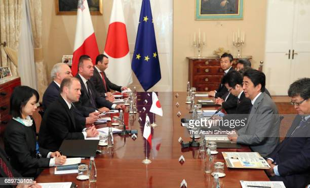 Japanese Prime Minister Shinzo Abe and Malta Prime Minister Joseph Muscat talk during their meeting on May 27 2017 in Balletta Malta