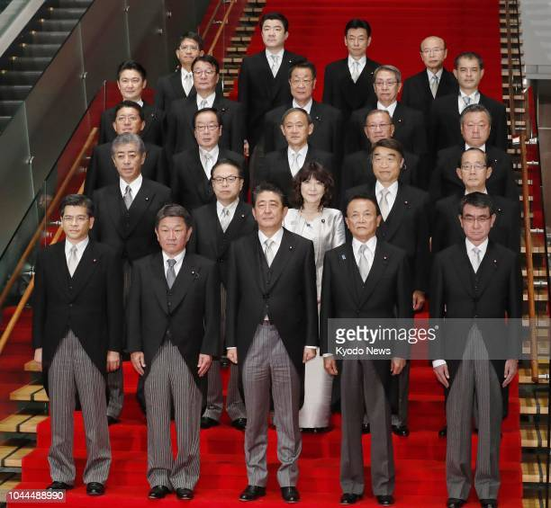 Japanese Prime Minister Shinzo Abe and members of his new Cabinet pose for photos at his office in Tokyo on Oct 2 2018 ==Kyodo