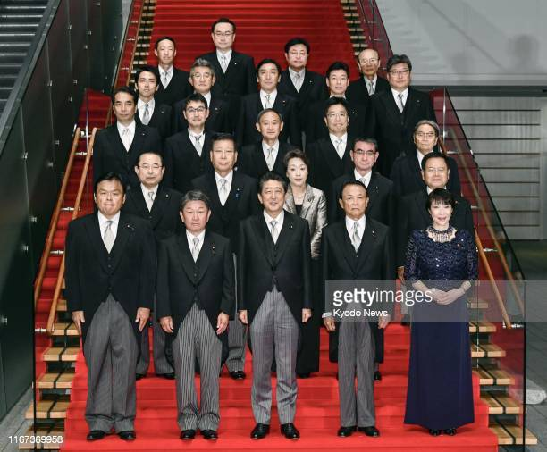 Japanese Prime Minister Shinzo Abe and members of his reshuffled Cabinet pose for a photo at his office in Tokyo on Sept 11 2019