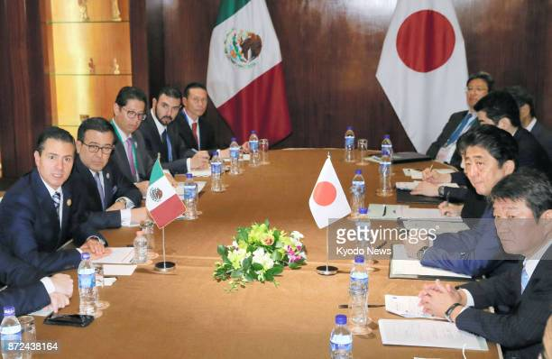 Japanese Prime Minister Shinzo Abe and Mexican President Enrique Pena Nieto hold talks in Danang Vietnam on Nov 10 on the sidelines of a summit of...