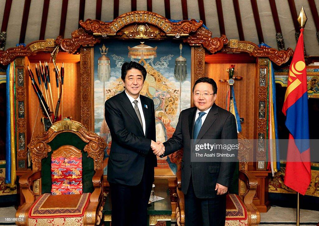Japanese Prime Minister SHinzo Abe and Mongolian President Tsakhia Elbegdorj shake hands prior to their bilateral summit on March 30, 2013 in Ulan Bator, Mongolia. Abe is on two-day tour to Mongolia to strengthen their bilateral relationship.
