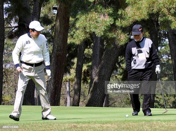 Japanese Prime Minister Shinzo Abe and New Komeito Vice Representative Kazuo Kitagawa play golf on April 6, 2014 in Chigasaki, Kanagawa, Japan.