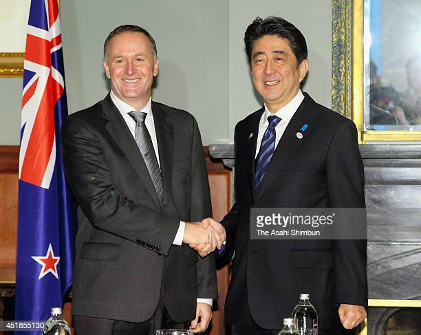 Japanese Prime Minister Shinzo Abe and New Zeland Prime Minister John Key shakes hands during their summit meeting on July 7 2014 in Auckland New...