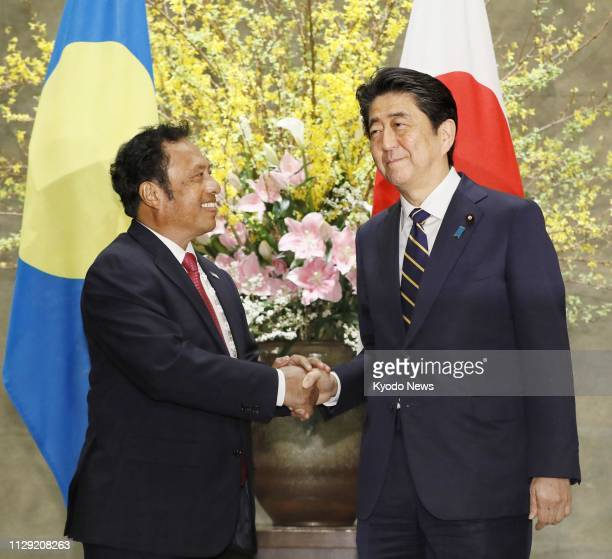 Japanese Prime Minister Shinzo Abe and Palauan President Tommy Remengesau shake hands at the prime minister's office in Tokyo on March 8 2019 ==Kyodo