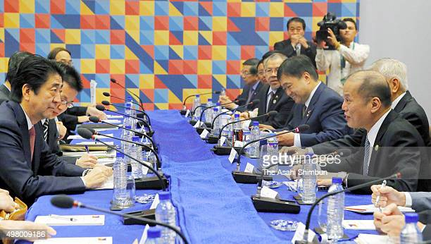 Japanese Prime Minister Shinzo Abe and Philippines President Benigno Aquino III talk during their bilateral meeting on the sidelines of the Asia...