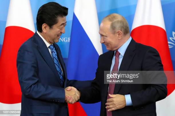 Japanese Prime Minister Shinzo Abe and Russian President Vladimir Putin shake hands after attending a joint press conference following their meeting...