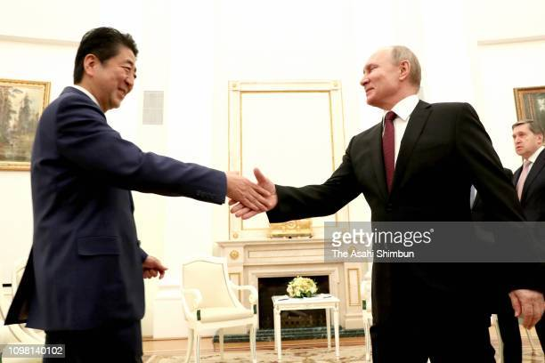 Japanese Prime Minister Shinzo Abe and Russian President Vladimir Putin shake hands during their meeting at Kremlin on January 22 2019 in Moscow...