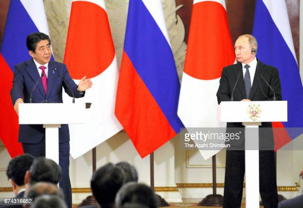 Japanese Prime Minister Shinzo Abe and Russian President Vladimir Putin shake hands during a joint press conference following their meeting at...