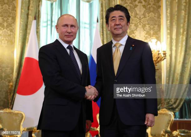 Japanese Prime Minister Shinzo Abe and Russian President Vladimir Putin shake hands prior to their meeting at Kremlin on May 26 2018 in Moscow Russia...