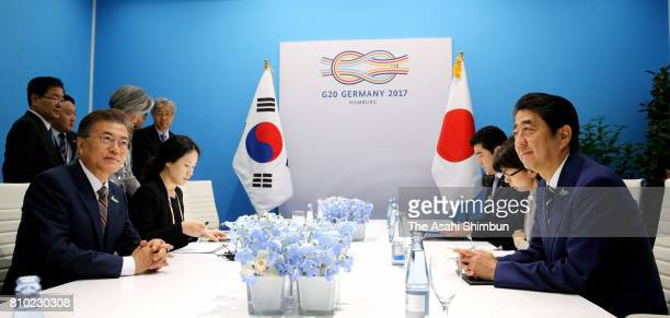Japanese Prime Minister Shinzo Abe and South Korean President Moon Jaein talk during their bilateral meeting on the sidelines of the G20 Summit on...