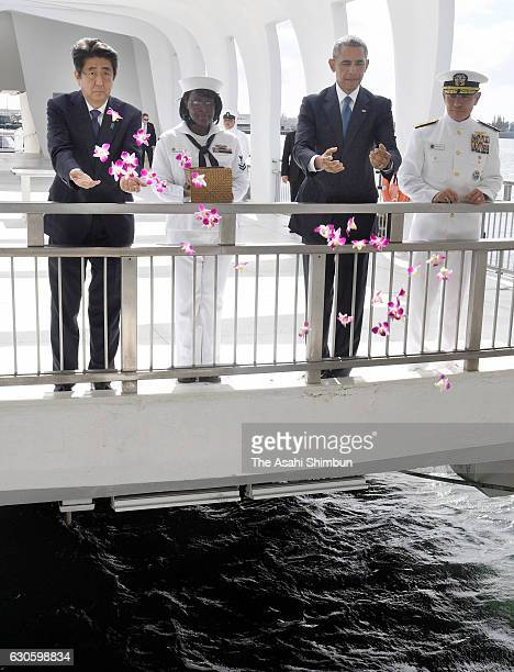Japanese Prime Minister Shinzo Abe and US President Barack Obama pay respect to those died in Pearl Harbor at the USS Arizona Memorial on December 27...