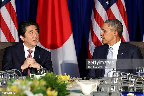 Japanese Prime Minister Shinzo Abe and U.S. President Barack Obama talk during their bilateral meeting on the sidelines of the Asia Pacific Economic...