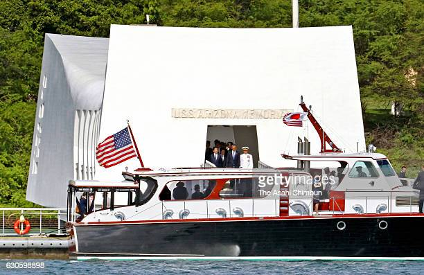 Japanese Prime Minister Shinzo Abe and US President Barack Obama leave the USS Arizona Memorial on December 27 2016 in Honolulu Hawaii Abe visits the...