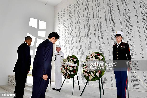 Japanese Prime Minister Shinzo Abe and US President Barack Obama offer wreaths to pay respect to those died in Pearl Harbor at the USS Arizona...