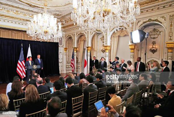 Japanese Prime Minister Shinzo Abe and US President Donald Trump attend a press conference after a North Korea's missile launch at Mar a Lago on...