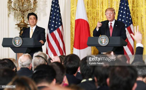 Japanese Prime Minister Shinzo Abe and US President Donald Trump hold a joint press conference following their talks at the White House in Washington...