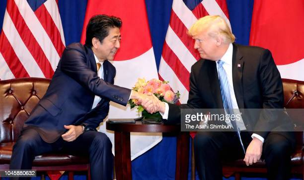 Japanese Prime Minister Shinzo Abe and US President Donald Trump shake hands during their meeting on September 26 2018 in New York City