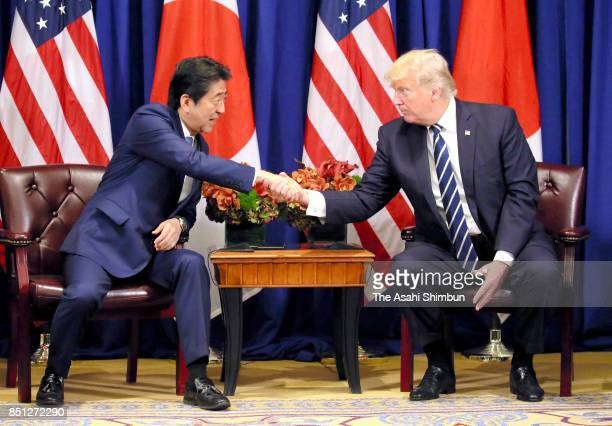 Japanese Prime Minister Shinzo Abe and US President Donald Trump shake hands prior to their meeting on September 21 2017 in New York City Abe is on...
