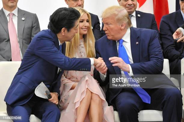 Japanese Prime Minister Shinzo Abe and U.S. President Donald Trump talk while advisor to U.S. President Ivanka Trump listens during the women's...