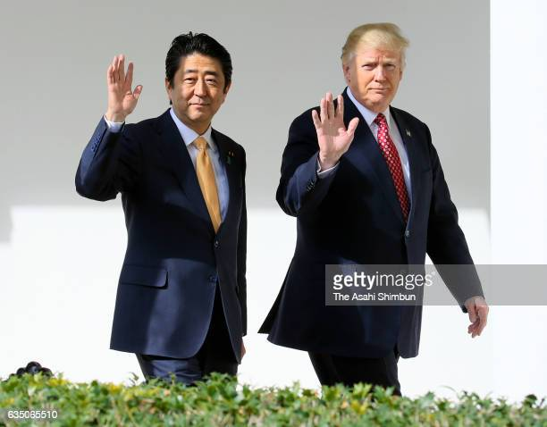 Japanese Prime Minister Shinzo Abe and US President Donald Trump walk together to their joint press conference in the East Room at the White House on...