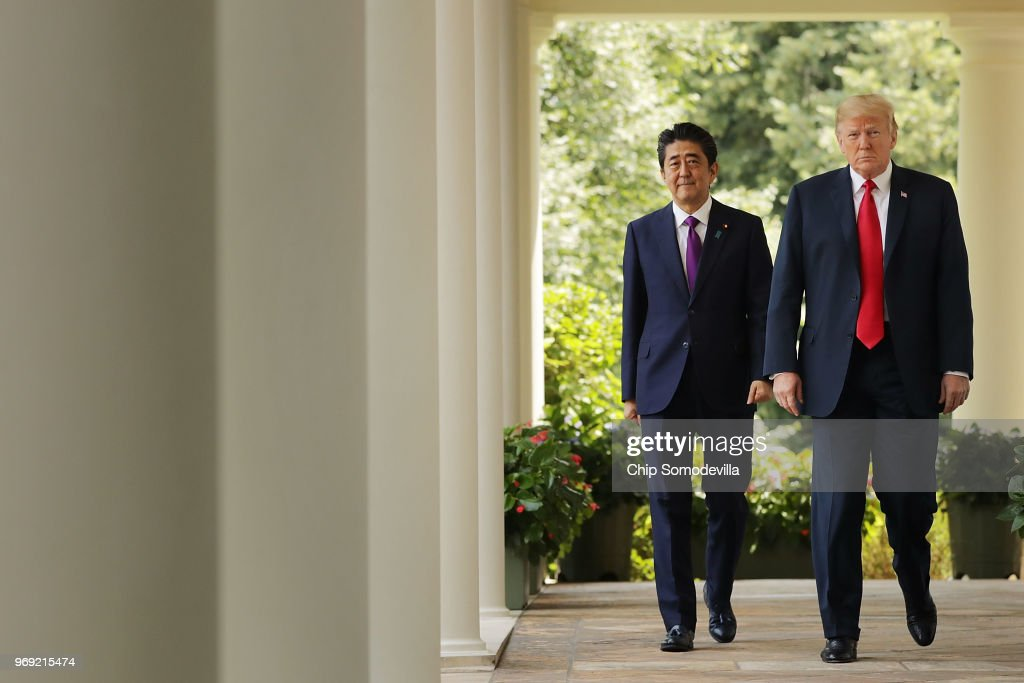 Japanese Prime Minister Shinzo Abe (L) and U.S. President Donald Trump walk along the Rose Garden colonnade as they arrive for a joint news conference at the White House June 7, 2018 in Washington, DC. Trump and Abe discussed the upcoming U.S.-North Korea summit.