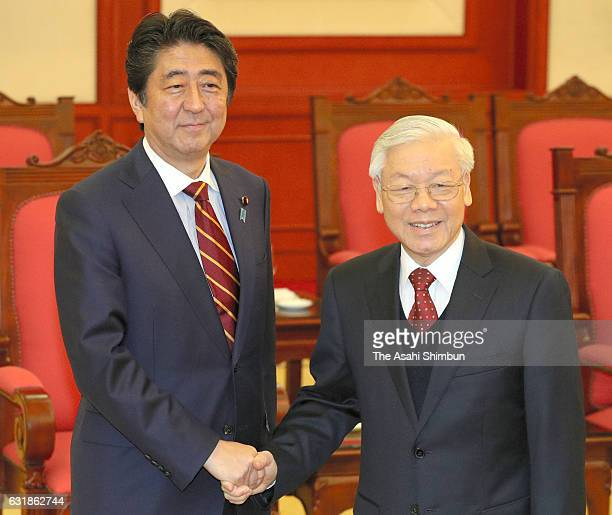 Japanese Prime Minister Shinzo Abe and Vietnam Communist Party General Secretary Nguyen Phu Trong shake hands prior to their meeting at the party...