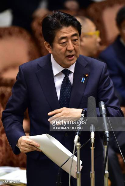 Japanese Prime Minister Shinzo Abe answers a question during the Upper House's ad hoc committee session for the controversial security bills at the...