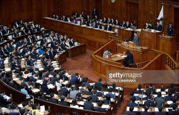 Japanese Prime Minister Shinzo Abe answers questions over his policy speech from Yukio Edano leader of the main opposition Constitutional Democratic...