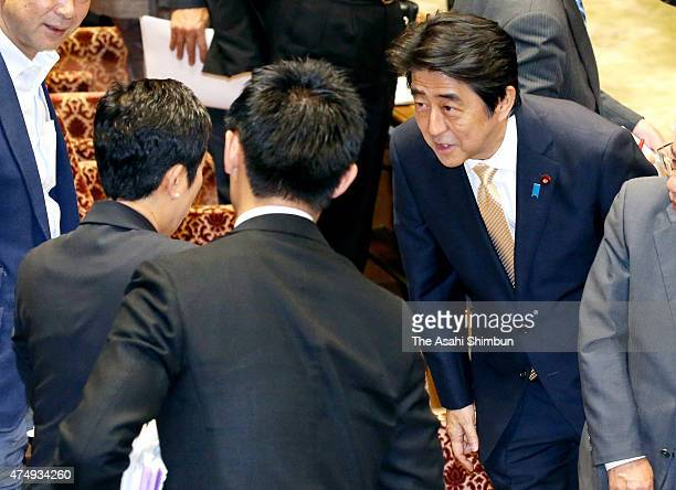 Japanese Prime Minister Shinzo Abe apologises to Democratic Party of Japan lawmaker Kiyomi Tsujimoto after a special committee to deliberate the 11...