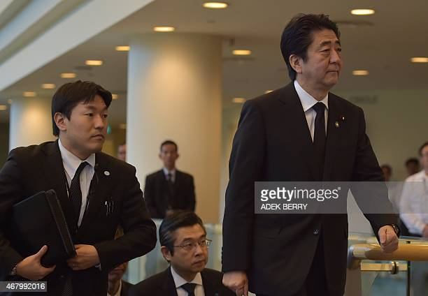Japanese Prime Minister Shinzo Abe arrives at the University Cultural Center for the funeral of Singapore's former prime minister Lee Kuan Yew in...