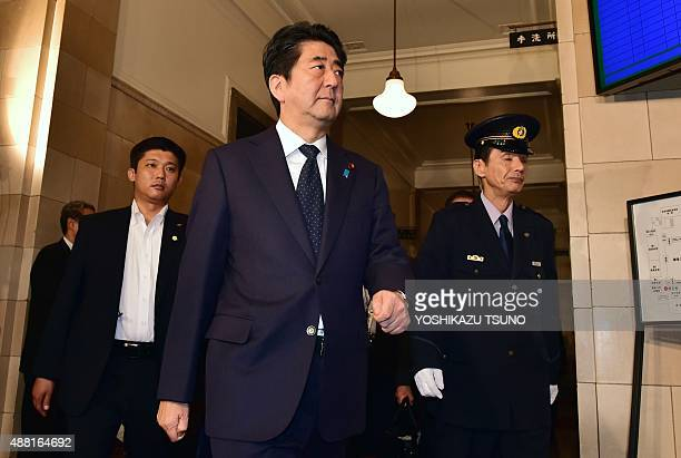Japanese Prime Minister Shinzo Abe arrives at the Upper House's ad hoc committee session for the controversial security bills at the National Diet in...